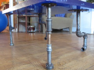 This table was made with glass from the Oregon Aquarium and retro pipe fittings.
